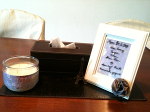 "The dry erase frame and matching candle on the dining table in a ""Less-is-more"" setting."